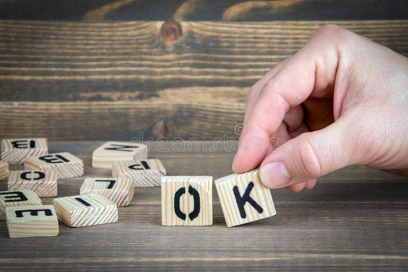 Ok. Wooden letters on the office desk, informative and communication background.  royalty free stock images