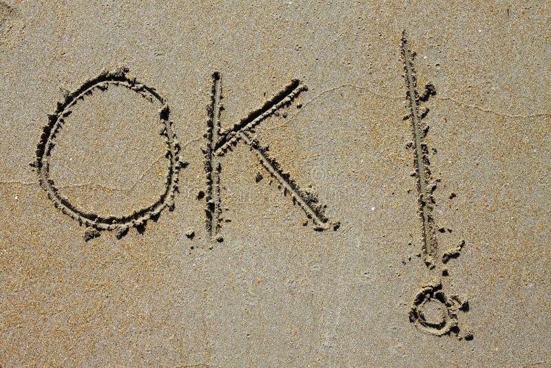 Ok Word Spell Written On Beach Wet Sand Stock Images