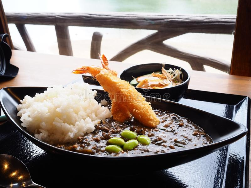 Okayama curry rice with tempura shrimp. Local traditional curry rice style in Okayama city Japan royalty free stock photography