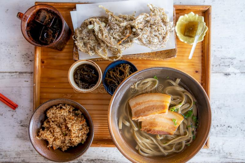 Okinawa Soba noodles with pork soft bone broth. Fire noodles with pork belly and Japanese soup stock photo