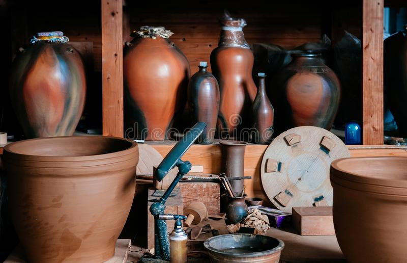 Ceramic clay pottery art, Ceramic vase with pottery making tools royalty free stock photos
