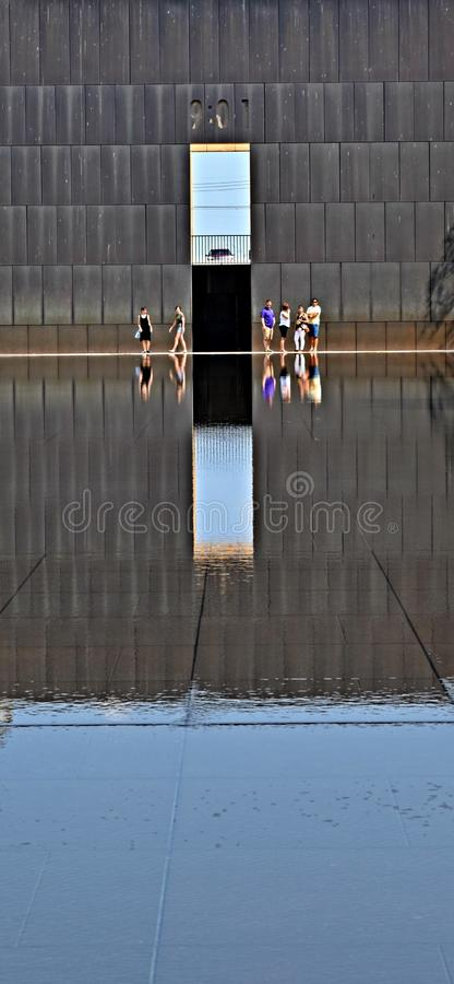 Oklahoma City Memorial, reflecting pond with time wall. Oklahoma City Memorial, reflecting pond with time wall in the background. Picture makes a good column royalty free stock photo