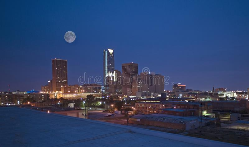 Oklahoma City skyline at night. Night photography. City under the moon. buildings at night. dark blue sky. building lit up. city scape royalty free stock photos