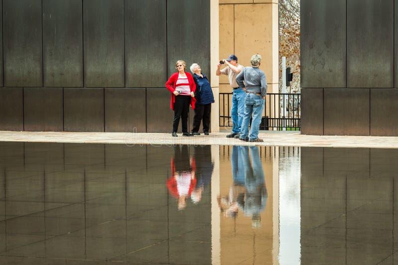 Older senior tourists walking at OKC Bombing Memorial. OKLAHOMA CITY, OKLAHOMA / USA - MARCH 31, 2018: Older senior tourists visit the Oklahoma City Bombing royalty free stock photography
