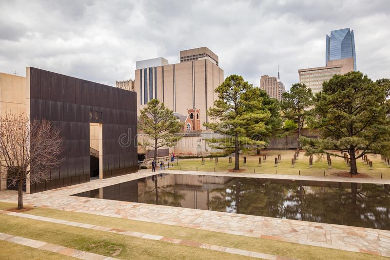 People Enjoying a visit to OKC Bombing Memorial. OKLAHOMA CITY, OKLAHOMA / USA - MARCH 31, 2018: People walking around and visiting the OKC Bombing Memorial and royalty free stock photos