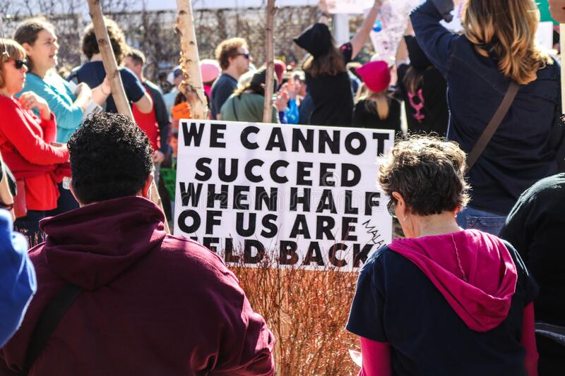 Womens March - protestors around sign that says We cannot succeed when half of us are held back. 2018_01_20 Oklahoma City USA -Womens March - protestors around royalty free stock photography