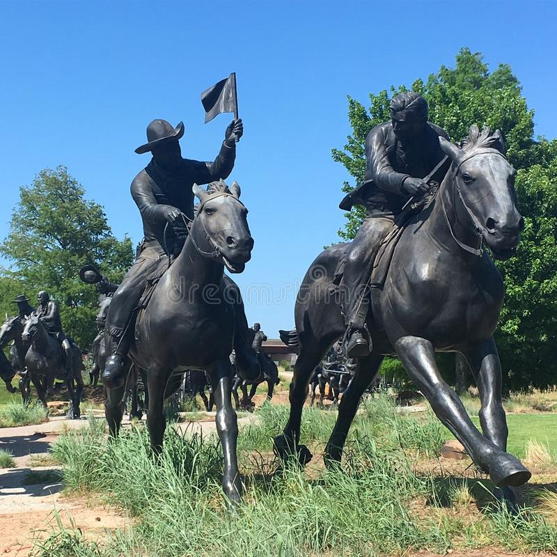 Oklahoma Land Run Monument. The Oklahoma Land Run Monument, created by sculpture Paul Moore recreates run the settlers participated when the frontier was stock photography