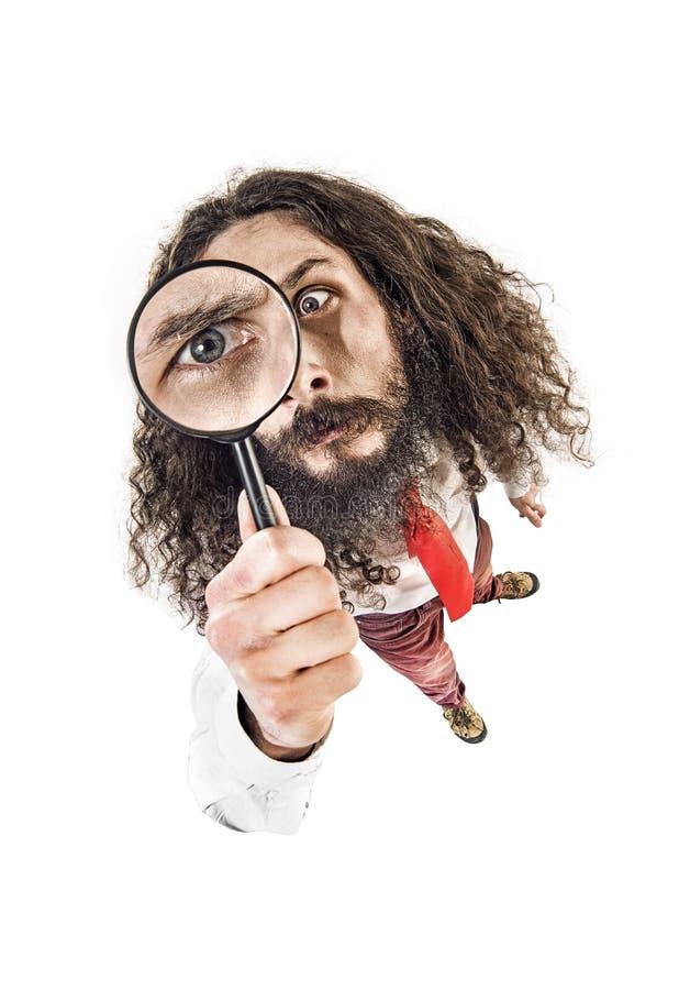 Oko wizerunek pracownik trzyma magnifier obraz royalty free