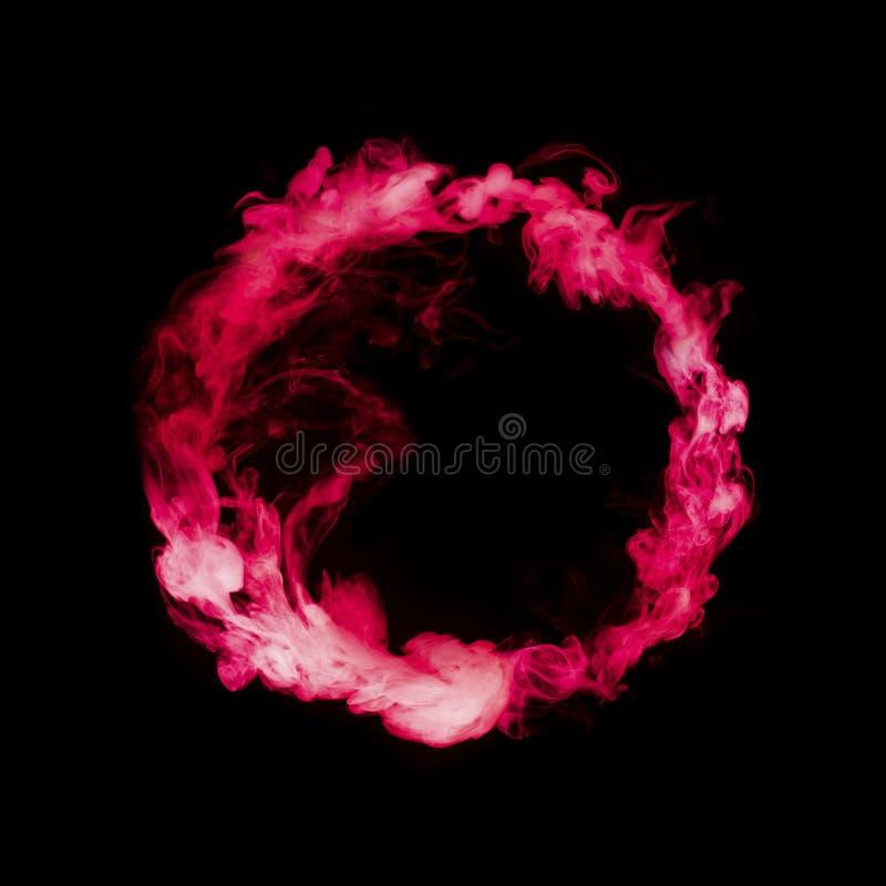 Okrąg od czerwonego kolorowego dymu obrazy stock