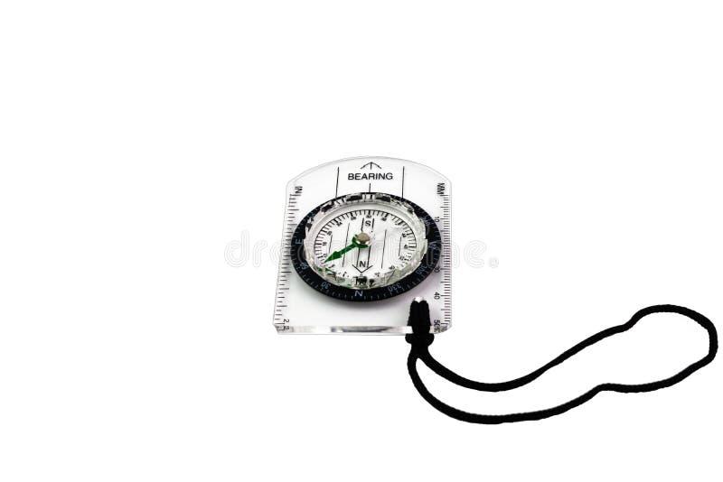 Okręgu kompas na przejrzystym klingerytu talerzu fotografia royalty free