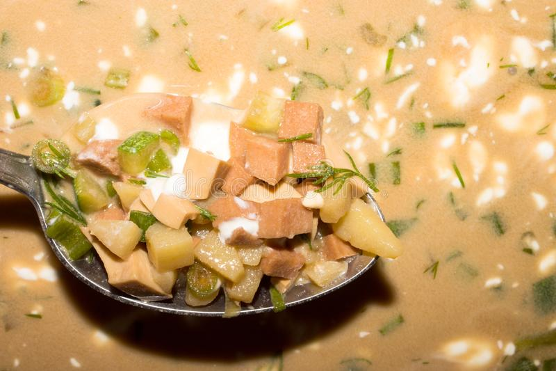 Okroshka on kvass. Background of okroshka on kvass with sausage and herbs royalty free stock images