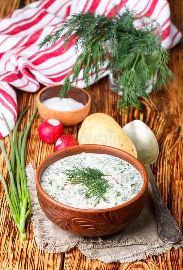 Okroshka. Summer light cold yogurt soup with cucumber, radish, eggs and dill royalty free stock images