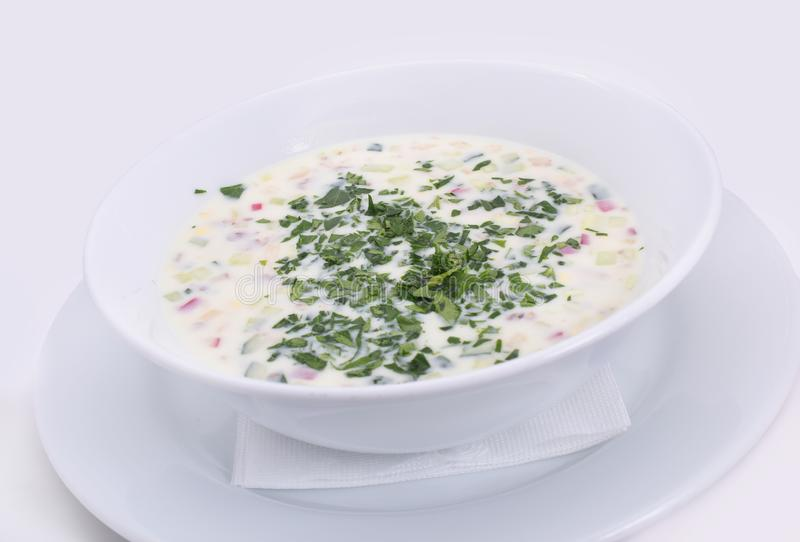 Okroshka. Summer light cold yogurt soup. Okroshka. Summer light cold yogurt soup with cucumber, radish, eggs and dill on white plate. Close-up. Top view stock photography