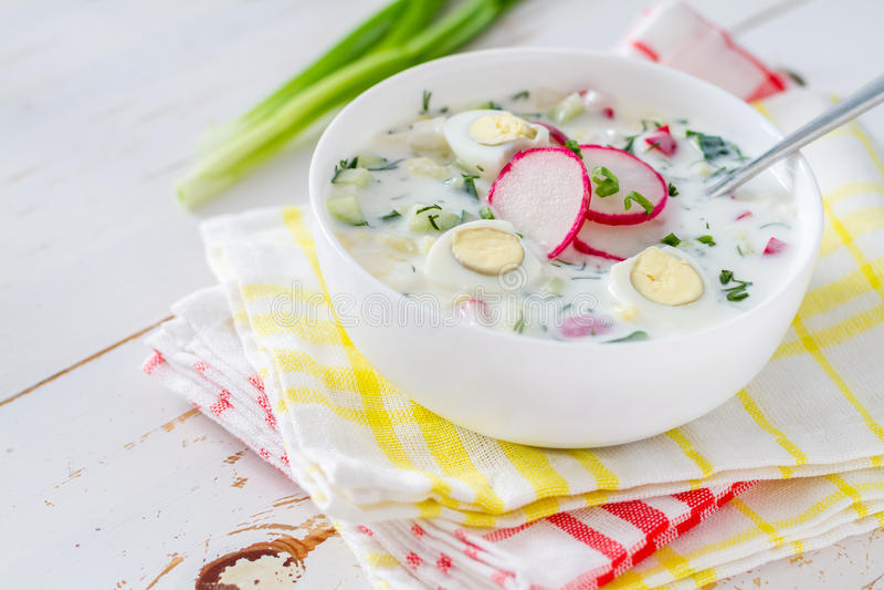 Okroshka - traditional summer cold soup. White wood background stock image