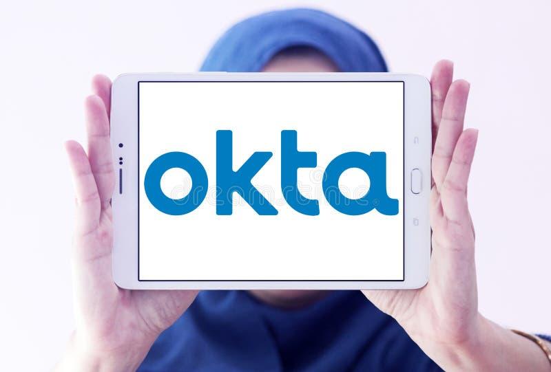Okta company logo. Logo of Okta company on samsung tablet holded by arab muslim woman. Okta is a publicly traded identity management company. It provides cloud royalty free stock photos