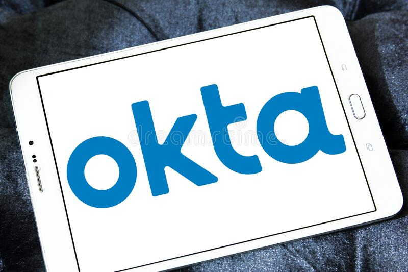 Okta company logo. Logo of Okta company on samsung tablet. Okta is a publicly traded identity management company. It provides cloud software that helps companies stock photo