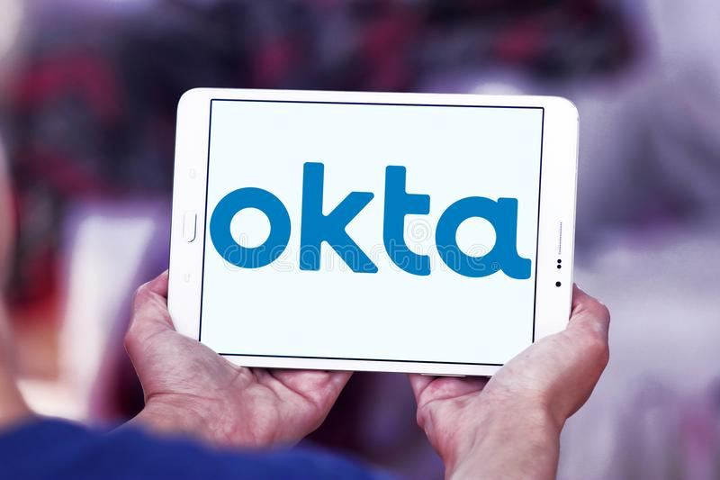 Okta company logo. Logo of Okta company on samsung tablet. Okta is a publicly traded identity management company. It provides cloud software that helps companies stock photos