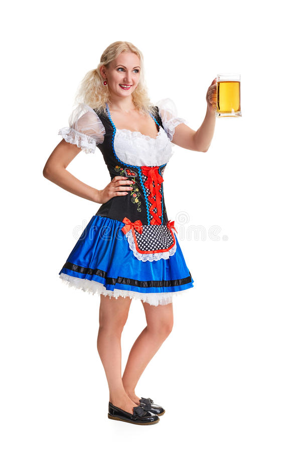 oktoberfest啤酒啤酒杯的美丽的年轻白肤金发的女孩 库存照片