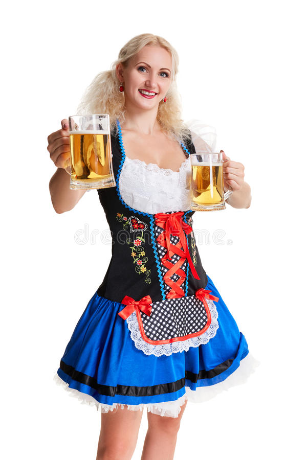 oktoberfest啤酒啤酒杯的美丽的年轻白肤金发的女孩 免版税图库摄影