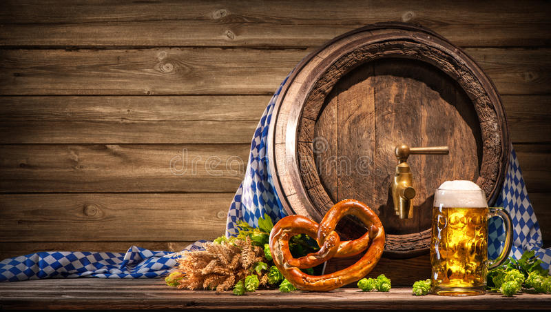 Oktoberfest beer barrel and beer glass stock photos