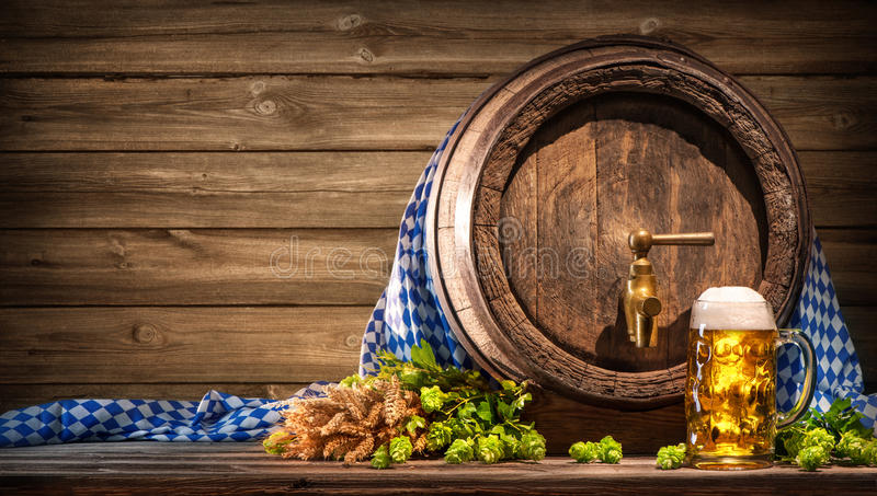 Oktoberfest beer barrel and beer glass royalty free stock photo