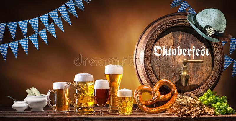 Oktoberfest beer barrel and beer glasses stock images
