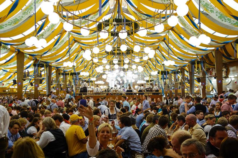 Oktoberfest beer festival in Munich, Germany. Visitors in a beer tent at the Oktoberfest in Munich, Bavaria, Germany, Europe royalty free stock photography