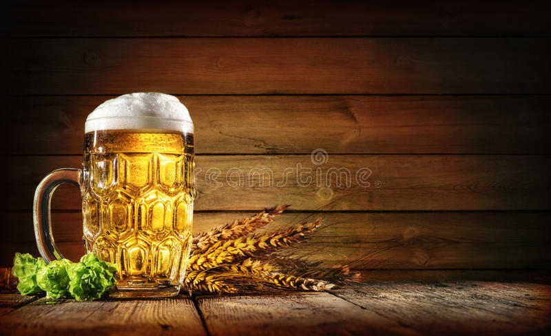 Oktoberfest beer with wheat and hops stock photography