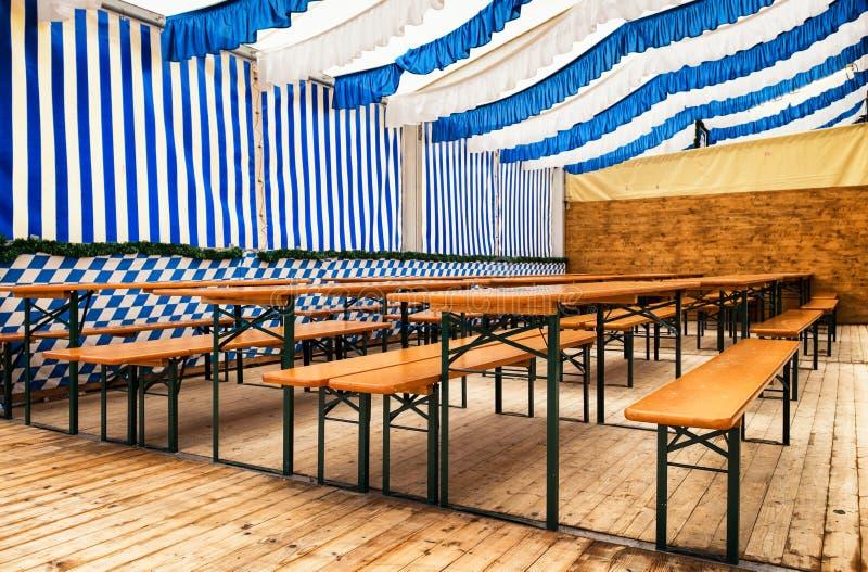 Oktoberfest. Chairs at a bavarian beergarden -oktoberfest royalty free stock photography