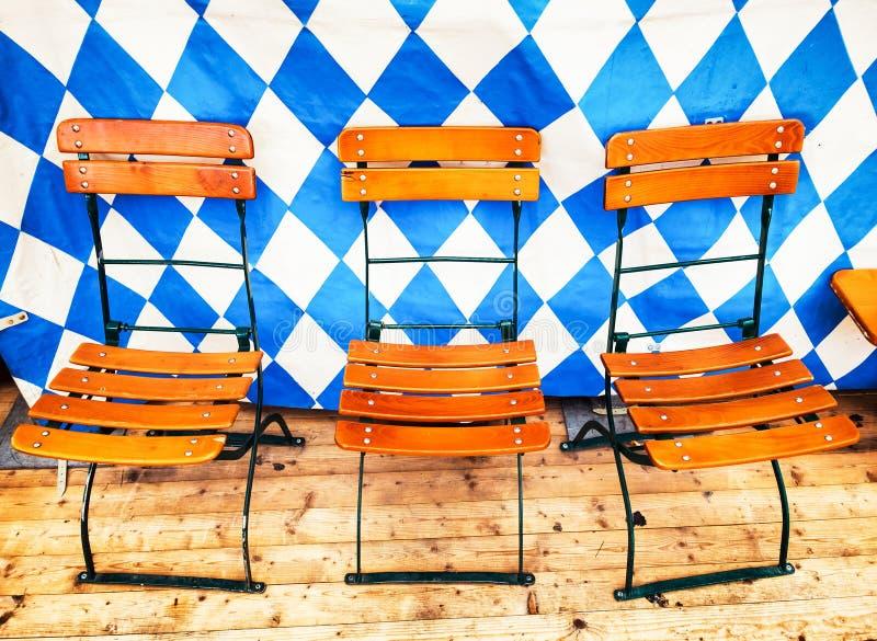 Oktoberfest. Chairs at a bavarian beergarden -oktoberfest stock photography