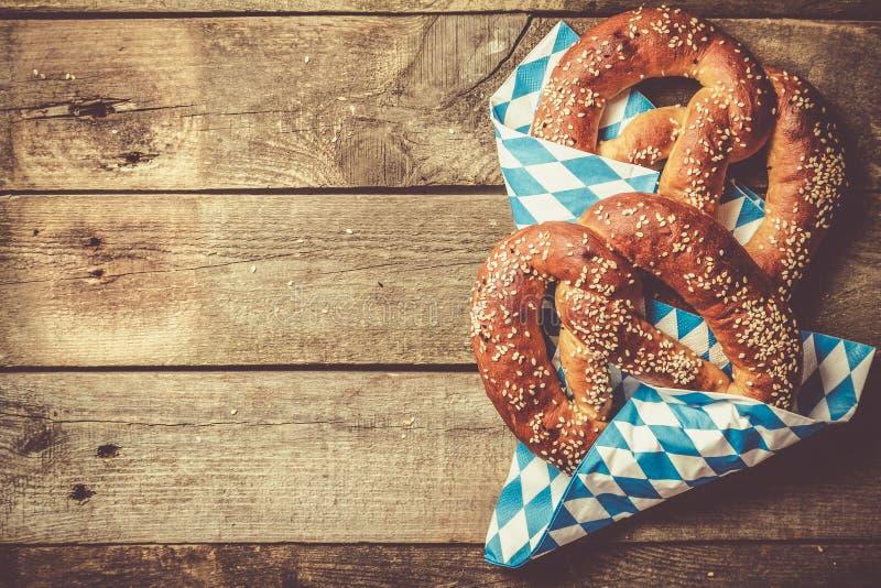 Oktoberfest concept - pretzels on rustic wood background royalty free stock photo