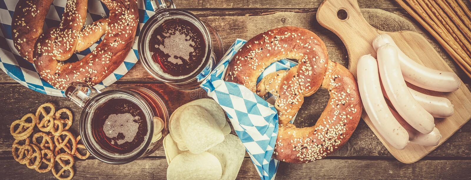 Oktoberfest concept - traditional food and beer on rustic background stock image