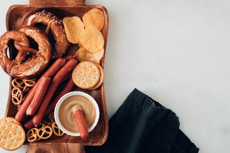 Oktoberfest food, appetizing beer snacks set for big company.Grilled sausages, chips, pretzel. Oktoberfest food, appetizing beer snacks set for big company royalty free stock images