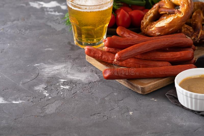 Oktoberfest food, appetizing beer snacks set for big company. Grilled sausages, salami, chips, pretzel crackers and. French fries served with spicy tomato sauce royalty free stock photography