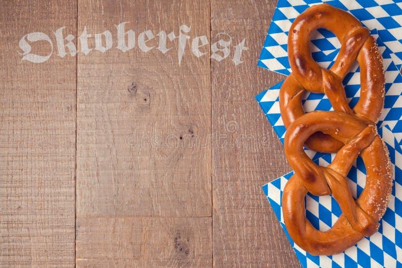 Oktoberfest German beer festival background with pretzel. On wooden table stock photos