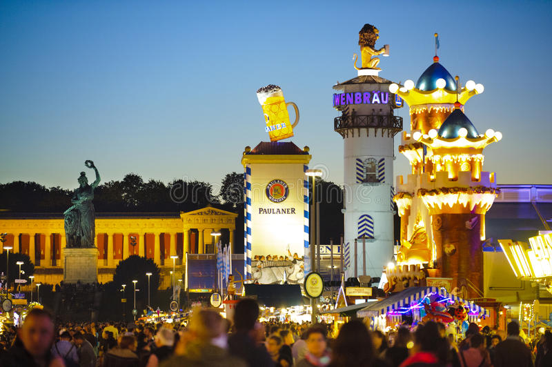 Oktoberfest in Munich. MUNICH, GERMANY - SEPTEMBER 23, 2014: The Oktoberfest in Munich is the biggest beer festival of the world.The guests are walking at the royalty free stock photo