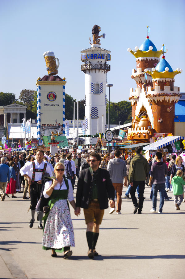 Oktoberfest in Munich. MUNICH, GERMANY - SEPTEMBER 23, 2014: The Oktoberfest in Munich is the biggest beer festival of the world. The visitors are walking at the royalty free stock images