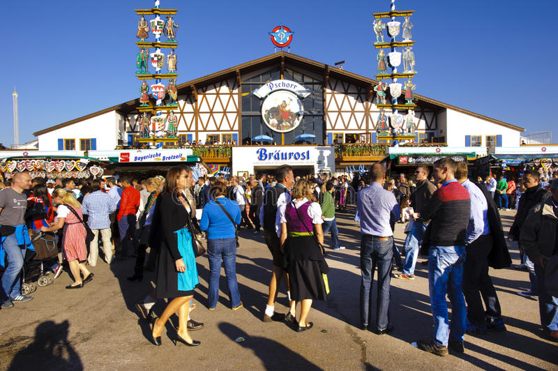 Oktoberfest in Munich. MUNICH, GERMANY - SEPTEMBER 23, 2014: The Oktoberfest in Munich is the biggest beer festival of the world. The visitors are walking at the stock photo