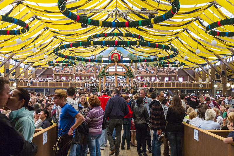Oktoberfest in Munich. On the traditional Oktoberfest in Munich with thousands people drinking good beer stock images