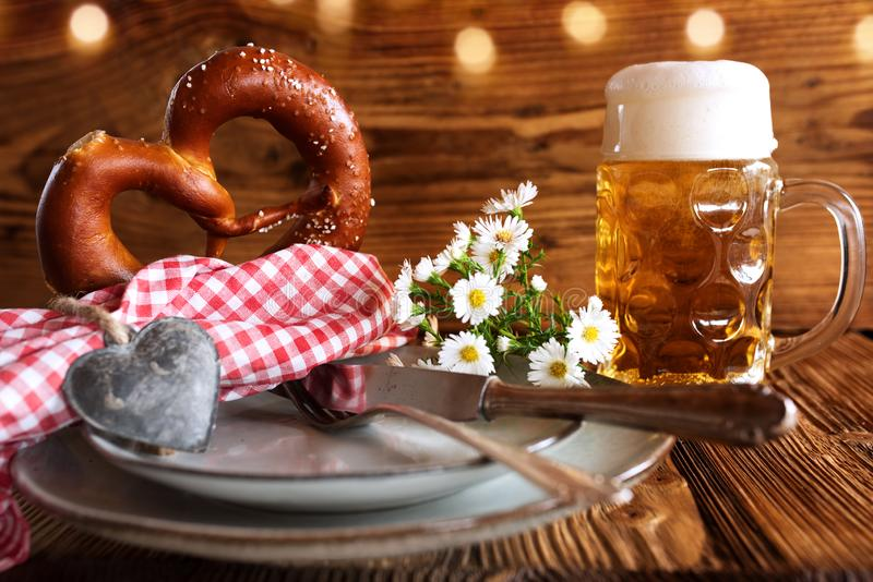 Oktoberfest place setting with beer and salt pretzel royalty free stock photo
