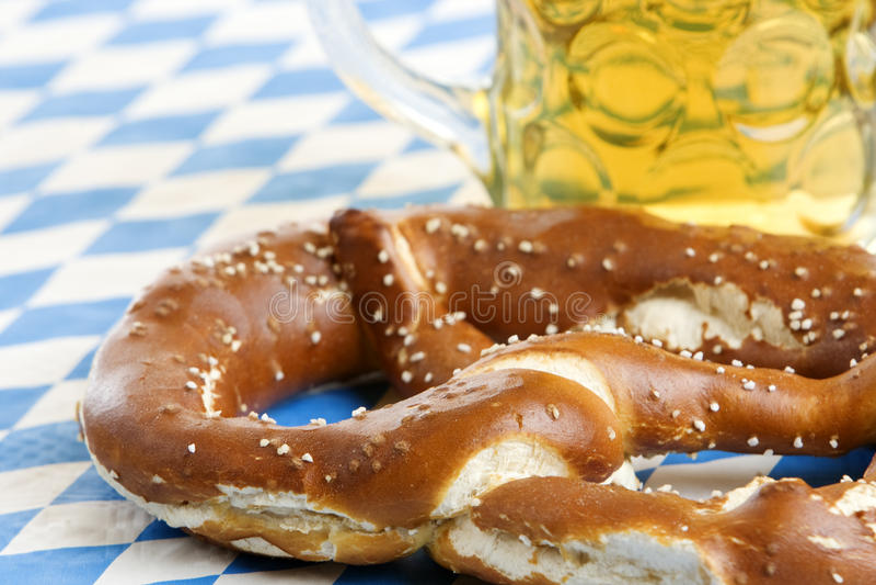 Oktoberfest Pretzel near beer stein (mug) stock images