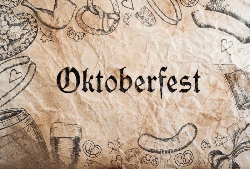 Oktoberfest sign with various hand drawn symbols, paper background. Studio shot stock illustration