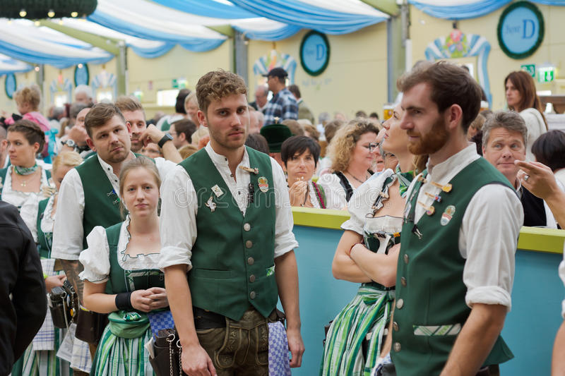 Oktoberfest Staff. MUNICH, GERMANY – SEPT. 19, 2015: Men and Women Staff in the Spatenbrau Tent with Traditional Costumes Serve Visitors at the Annual royalty free stock photos