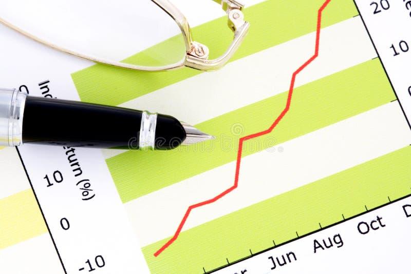 okularów zarobki wykresu długopisy pozytywnie obrazy stock