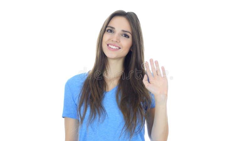 Olá!, olá!, mão de ondulação da mulher, boa vinda, retrato no fundo branco imagens de stock royalty free