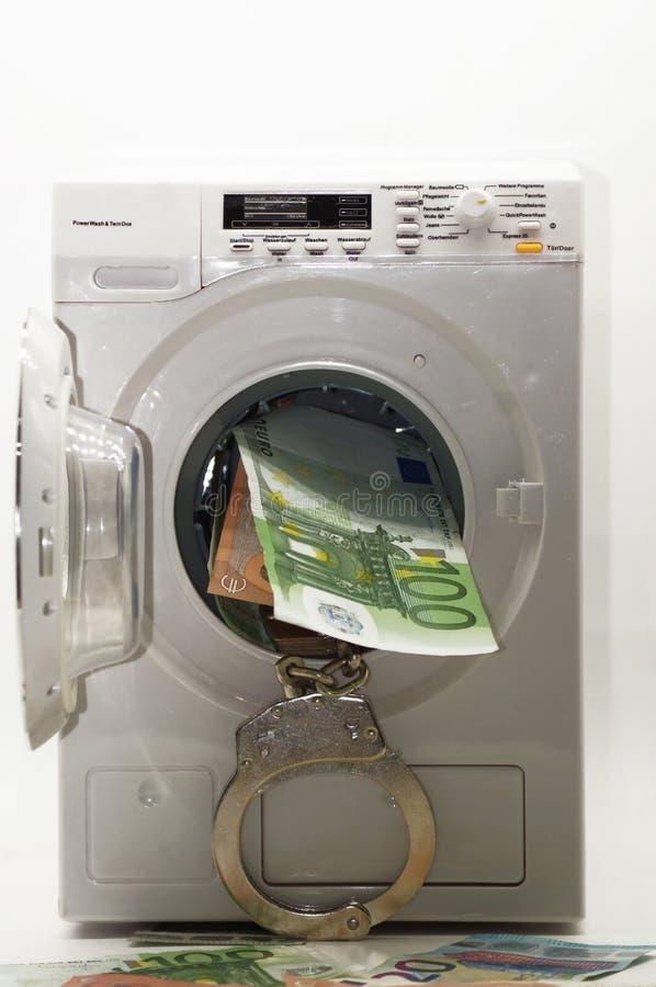Olagliga penningtvättsvartpengar släppta på vit bakgrund royaltyfri fotografi