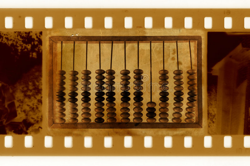 Old 35mm frame photo with vintage abacus royalty free stock photo