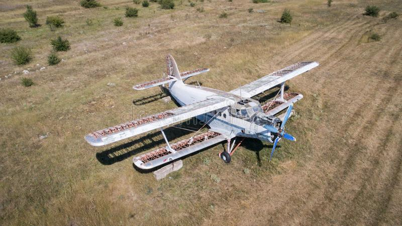 Old abandoned airplane on the field. Top view stock photography