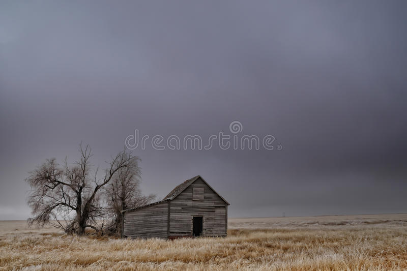 Old Abandoned Barn in an Empty Field royalty free stock photography