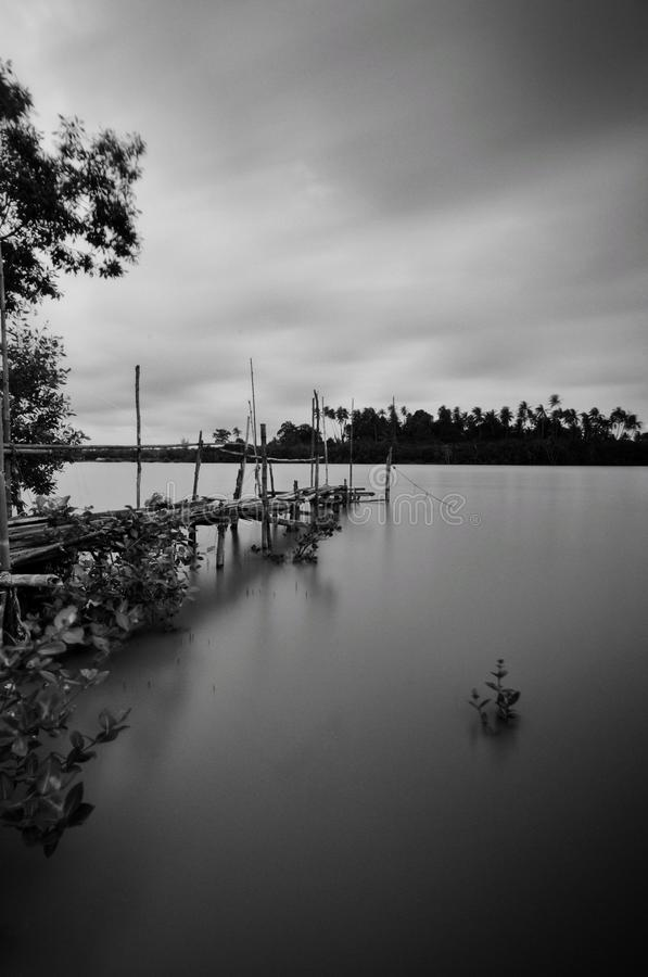 Old abandoned bridge at fisherman village. Old abandoned bridge fisherman village black white fine art sky beauty nature water malaysia wood material stock photography